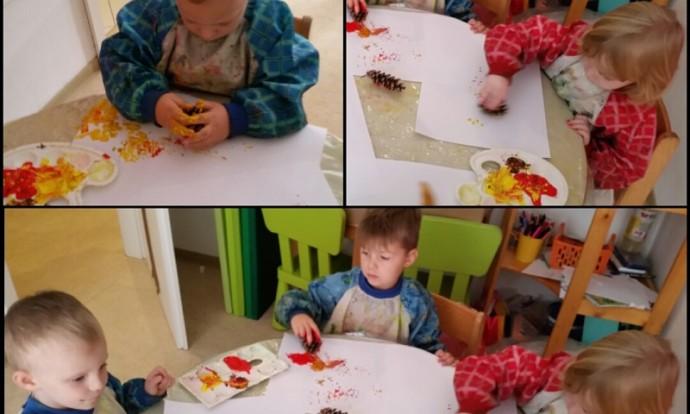 Leptirići - likovna aktivnost, istraživanje tempere i stavljanje u međuodnos s plodovima jeseni, preslikavanje boje sa češera na papir