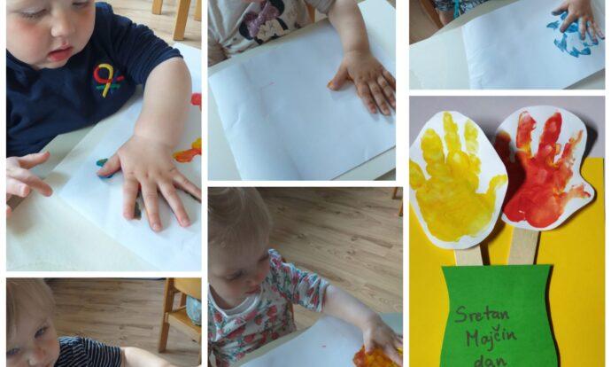 Bubamare - Obilježavanje Majčinog dana; likovna aktivnost otiskivanje ruke na papir i izrada cvijeća, razvoj taktilne percepcije te kreativnosti