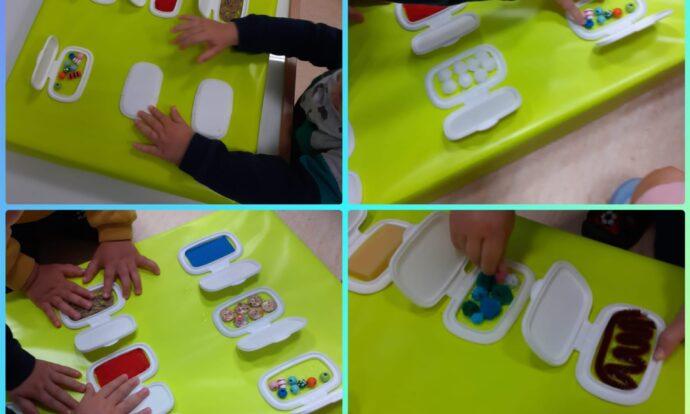 Lavići - stolno-manipulativna aktivnost istraživanja senzorne ploče; Uočavanje sličnosti i razlika između postavljenih materijala te razvijanje hvata i mišića prstiju otvaranjem i zatvaranjem poklopca